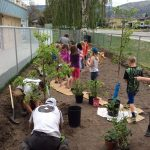 olunteers help Parkway Elementary students plant the Food Forest Garden.